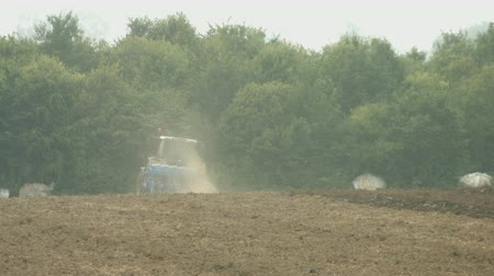 video footage of a tractor with a plow on a acre in germany Stock Footage