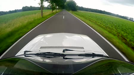 Timelapse 4K UHD video: Driving with on a landscape in germany with a camera at the roof of the car