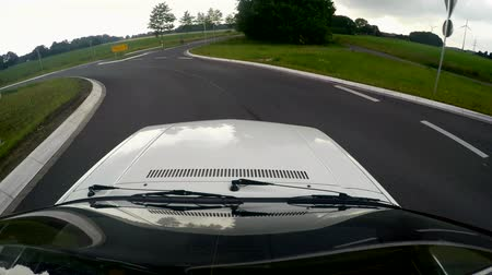 On-board camera on the roof of a old car driving on a country road. germany Stock Footage
