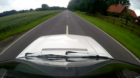 On-board camera at the roof of a car. Driving on a rural street in germany