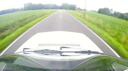Video footage: Driving with on a country road with a on-board camera at roof in forest in germany