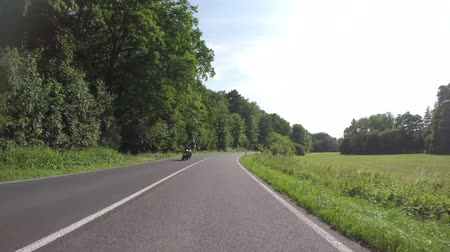 video footage of some motorbikes driving in summer on a twisting road in germany