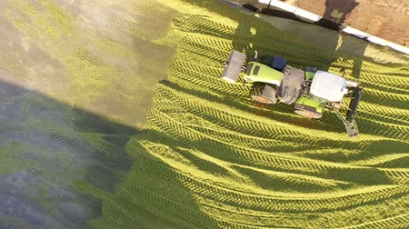 aerial video footage of a tractor biogas plant in germany Stock Footage