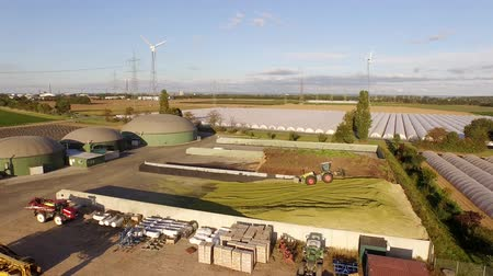 aerial video footage of a biogas plant with 3 fermenters in germany Stock Footage