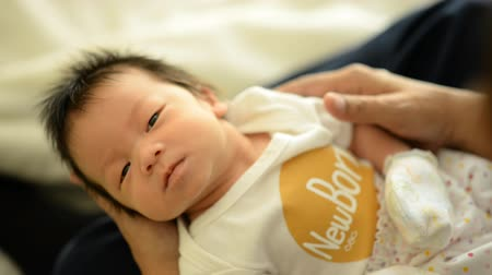 adorable : Asian cute New born baby with newborn cloth close up