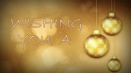 atmosféra : Golden Ornament Seasons Greetings Text Loop features gold Christmas ornaments spinning on a background of animated bokeh lights and animated holiday message