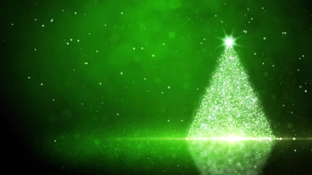 atmosféra : Green Glitter Tree with Snow Particles Background features a glittering Christmas tree on an atmospheric green background loop with empty area for your text
