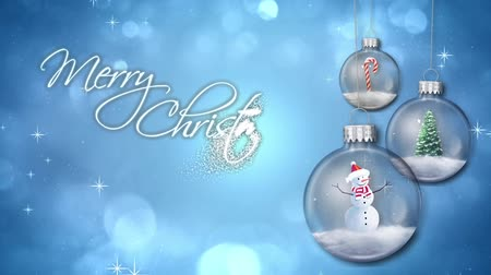 частицы : Swinging Ornaments on Blue Merry Christmas Text Loop features swinging glass ornaments filled with pine tree snowman and candy cane on blue atmospheric background with an animated Merry Christmas message Стоковые видеозаписи