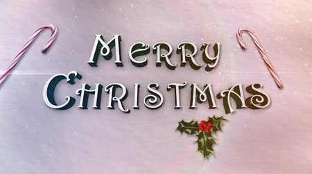 atmosféra : Snowy White Merry Christmas features animated camera moves with close shots of letters with soft snow flakes falling and ends in a full shot of the Merry Christmas message Dostupné videozáznamy