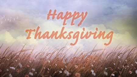 požehnat : Seasons Turning Happy Thanksgiving features billowing clouds in the background and a field ready for harvest blowing in the wind with animated happy thanksgiving message