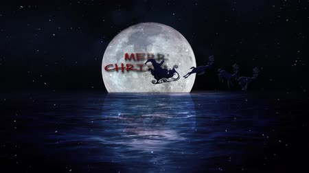Santa Fly Merry Christmas Moon on Water 4K features a full moon hanging low over water with Santa flying across the moon and revealing a Merry Christmas. Wideo