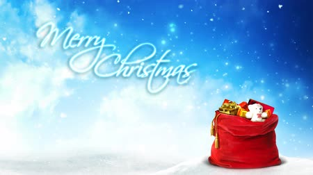Santa Present Bag Glitter Rising Merry Christmas 4K Loop features a red Santa bag full of presents sitting in the snow with swirling snow, clouds, and glitter particles rising in the background and an animated text saying Merry Christmas