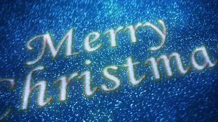 sob : Santa Snowfall Particles Merry Christmas 4K features a clouded full moon with a silhouette of Santa flying across and then the camera moving down to show a snowfall revealing a Merry Christmas message Dostupné videozáznamy
