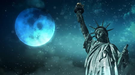 sob : Statue Of Liberty in a Winter Snow 4K Loop features the Statue of Liberty with snow falling, clouds moving, and a full moon in the sky in a loop