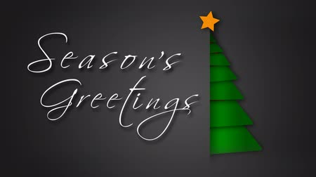 Unfolding Green Paper Season's Greetings Tree 4K feature a gray envelope background with paper pieces animating out to make a green Christmas tree with an animated hand-written Merry Christmas message