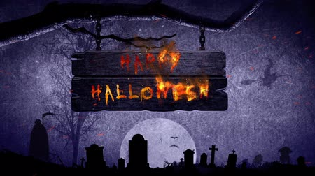 sírkő : Happy Halloween Flaming Sign 4K Loop features a sign hanging from a dead tree and bursting into flames revealing a Happy Halloween message Stock mozgókép