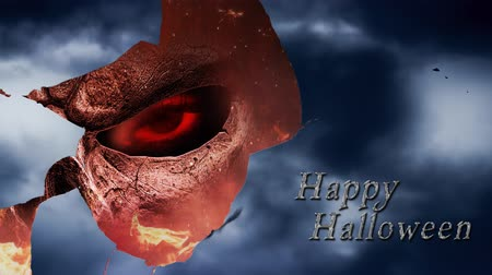smashing : Mirror Smash Skull from Hell Happy Halloween 4K features flying bats in a cloudy sky reflected in glass that breaks and reveals a skeletal creature looking out at the viewer with flames and a happy Halloween message