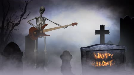dia das bruxas : Skeleton Graveyard Jam Happy Halloween 4k features a skeleton playing an electric guitar in a foggy graveyard with Happy Halloween animating in flames on a tombstone