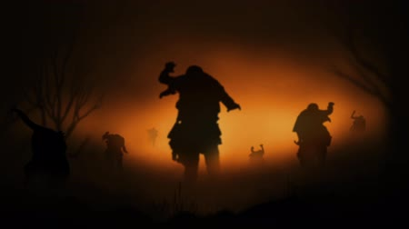 gravestone : Zombie Hoard at Dusk 4K features zombie silhouettes walking forward in a roiling fog with an atmospheric fiery sunset in the background