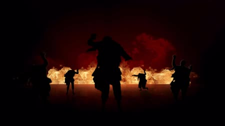 headstone : Zombie Fire Silhouette 4K features zombies silhouettes walking forward on a reflective surface with a raging fire in the background with one zombie caught behind the fire Stock Footage