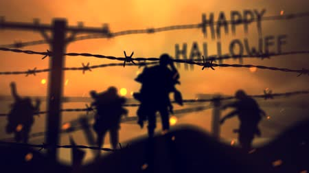 farpado : Barbwire Zombies at Sunset Happy Halloween 4K Loop features zombie silhouettes walking forward viewed through strands of barbed wire with moving clouds and particles in the atmosphere with Happy Halloween hand written in the background.