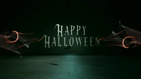 Happy Halloween Green Grunge Smoke Atmosphere 4K Loop features a camera flying in about a grungy concrete floor with a puff of smoke and particle lines coming out from the center to reveal the words Happy Halloween. Wideo