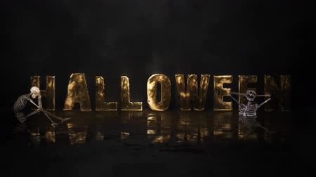 sutil : Happy Halloween Golden Reflection 4K Loop features a wet reflective surface with subtle smoke and lights panning across revealing the words Happy Halloween in metallic gold with and skeleton symbols in a loop and very elegant