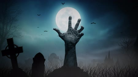 sírkő : Haunted Graveyard Zombie Hand Out of Ground 4K Loop features a hand protruding up from the ground with subtle movement with a full moon and gravestones around with animated fog and bats in the background in a loop