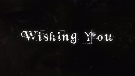 sutil : Wishing You a Dark Halloween 4K Loop features animated text floating and disintegrating on screen with a subtle set of dark eyes watching the viewer from background