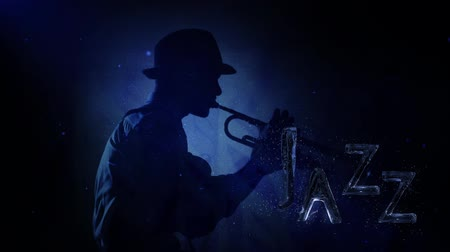 "kalça : Liquid Jazz with Water text 4K features a Jazz musician playing a horn with a spot backlighting and sparkles with liquid text animating on screen that says ""Jazz"" Stok Video"