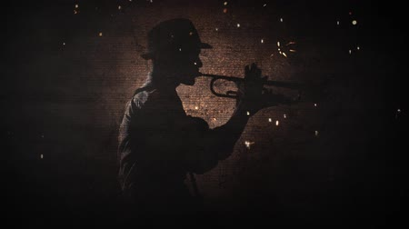 trąbka : Sparking Jazz Silhouette 4K features a Jazz musician playing a horn with a grunge rock wall behind him and sparks flying with a smoke atmosphere
