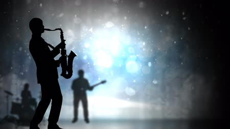 fade in : Jazz Musician Silhouettes and Glitter 4K Loop features animated musician silhouettes with a panning camera and a black fade in fade out with light blue glitter atmosphere in a loop