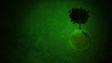 Earth Day Tree Globe Grow Background 4K Loop presenta un fondo grunge verde con un globo giratorio y un árbol en la parte superior en un bucle.