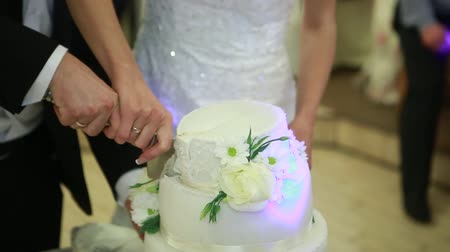 wedding cake : hand cut the wedding cake brides Ukraine