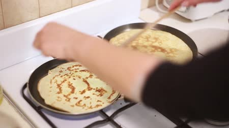 panquecas : Woman at home preparing for two Pancake pans Ukraine