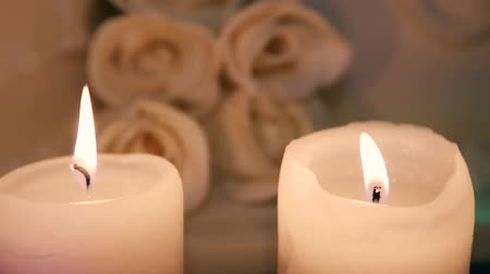 tiered : Candle burning in the background of a wedding cake Stock Footage