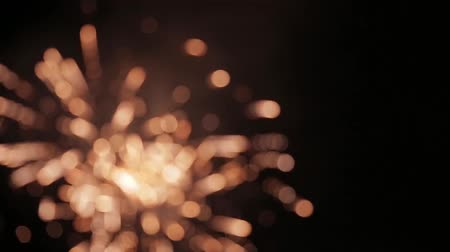 четверть : Fireworks blurs of light in this stylized shot set out of focus Стоковые видеозаписи