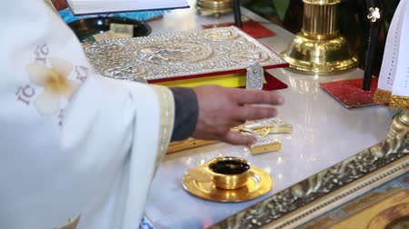eucharystia : the priests hand baptizes a cup of wine