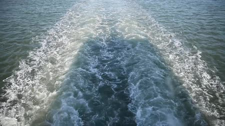 trail on the waves from a floating ship