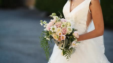 fiancee : wedding bridal bouquet of flowers in hands of the bride
