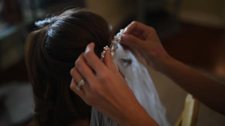 salon : wedding, hair stylist makes the bride