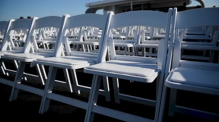 settings : White chairs in a beautiful wedding ceremony. Wedding.