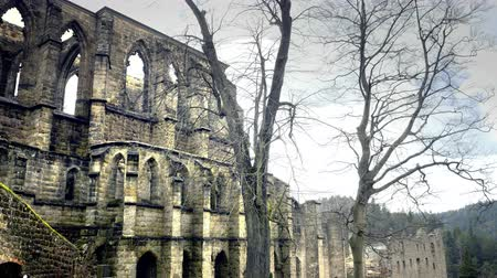 Gothic cathedral without roof. Ruins of the medieval castle. Royal City. Scary giant building, huge defensive fortification tower and bulwark. Spring sunny day, without people. Oybin in Germany.