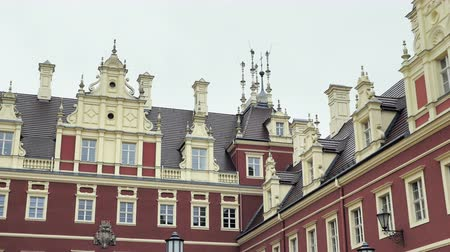 düzeltme : Classicist castle with yellow, red facade. Monumental palace with moat, sculptural decoration