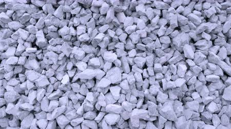 reinforced concrete : Gravel of large fractions. Crushed stone, building aggregate, stone structure. Pile of building material