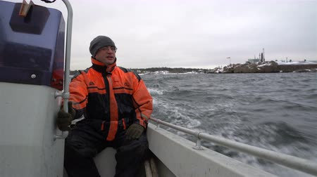 subsistence : Brave Fisherman on a small boat out to sea to fish in the Baltic sea.