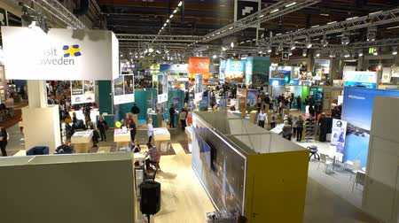 ярмарка : HELSINKI, FINLAND - NOVEMBER 22, 2017: A lot of people in the large international fair of travel agencies Matka Nordic Travel Fair 17 in Expocentre Messukeskus.