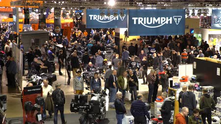 obchody : HELSINKI, FINLAND - FEB 03, 2017: Motorcycles, mopeds, scooters, riding gear, spare parts and many people at the largest motorcycle show in the Nordic countriesries MP17.