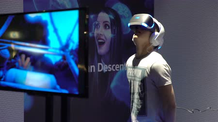 playstation : HELSINKI, FINLAND - NOVEMBER 4, 2016: Young people with pleasure uses VR head-mounted displays. New Virtual reality games by PlayStation. Young people with pleasure uses VR head-mounted displays. GAME EXPO in the exhibition center Messukeskus. Stock Footage