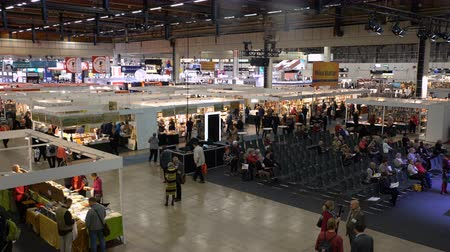 bookshop : HELSINKI, FINLAND - OCTOBER 27, 2016: Many lovers of reading, buyers, publishers and books at the big book fair. Most of the book fair at the Expocentre Messukeskus Stock Footage